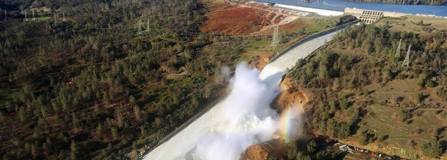 Aerial photo released by the California Department of Water Resources, showing the damaged spillway with eroded hillside in Oroville